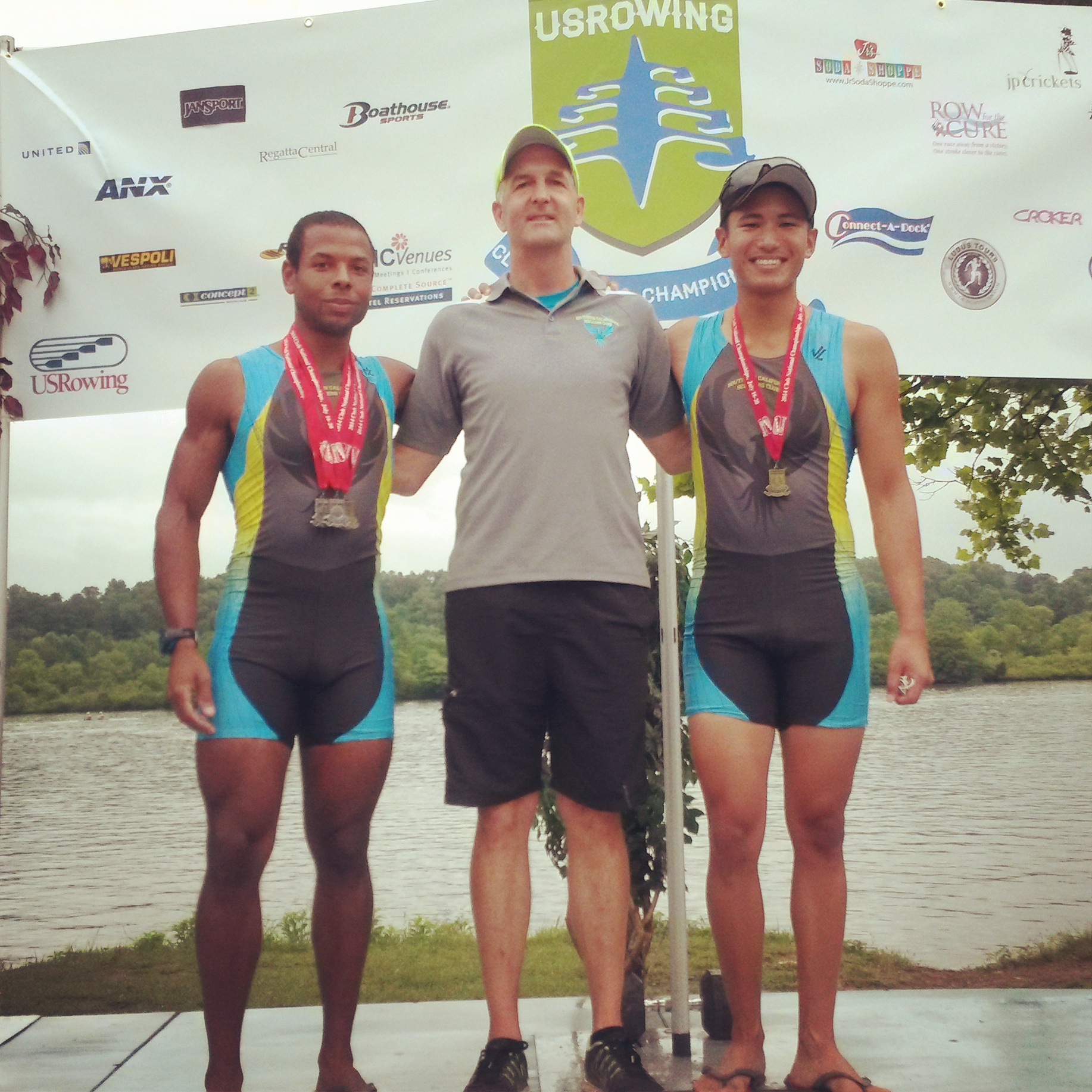 One of my coaches, Dan McGill (center), my Int. Lwt 2X partner, Derrick, and Me. Proudly wearing my medals (2 x silver, 1 x gold)